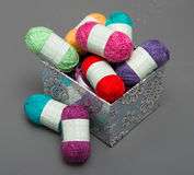 Small multicolored balls of wool Stock Photo