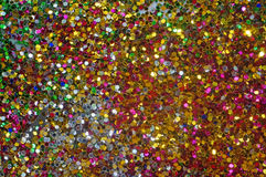 Small multicolored sequins as background Royalty Free Stock Photo