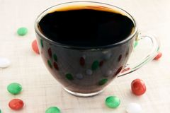 Small multicolored sweets. Hot black tea. Reflection. Light white background Stock Image