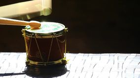 Small music drum wooden sticks hd footage. Day light