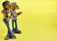 Small musician statue. On yellow background stock photo