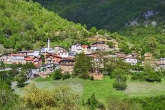 Small muslim village. Small Macedonian muslim village located on a mountain near Albania royalty free stock images