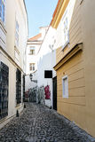 A small narrow street in the old town area of Prague Royalty Free Stock Image