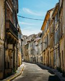 Small narrow streets in the quaint Provencal city of Arles, on the River Rhone royalty free stock image
