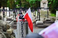 Small national pennon of Poland on the old cemetery. National Armed forces day concept. Small national pennon of Poland on the cemetery. National Armed forces Royalty Free Stock Photo