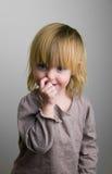 The small naughty girl stock photos