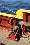 Small naval cannon on board Stock Photography