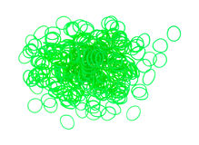 Small neon green plastic loom loops Stock Photography