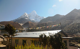 Small Nepali village and Ama Dablam behind Stock Image