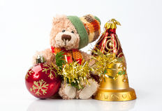 Small New Year`s bear. The toy, a small New Year`s bear with a hat and scarf and Christmas decorations Royalty Free Stock Photography