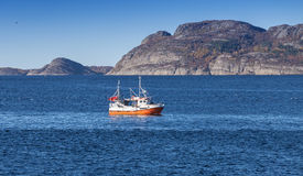 Small Norwegian fishing boat goes on fjord Royalty Free Stock Photo