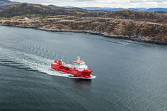 Small Norwegian red oil products tanker. Sails in the fjord Royalty Free Stock Image
