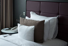 A small note on the bed with pillows. Note on the bed Stock Photo