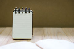 Small note book paper notepad stand for writing information with pencil and book Stock Image