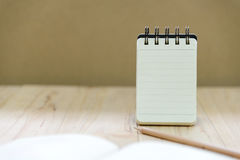 Small note book paper notepad stand for writing information with pencil and book Stock Photography