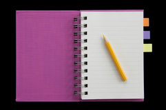 Small notebook fist page open and yellow pencil Stock Photo