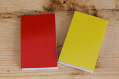 Small notepad. Two notes,red and yellow Stock Photography