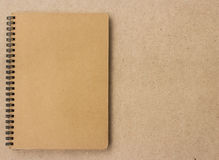 Small notepad on wood Stock Images