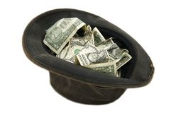 Small notes of dollars in the hat Royalty Free Stock Photography