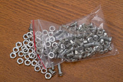 Small nuts and bolts Stock Image