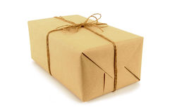Small oblong parcel or package tied with string, isolated on white background Royalty Free Stock Photo