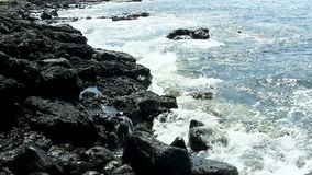 Small Ocean Waves Against Black Lava Rock Shore Kona Hawaii stock footage