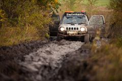 Small off road car stuck in deep mud Stock Image