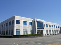 Small office building. A small office building and parking lot Stock Photography