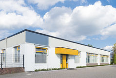 Exterior Of A Small Office Building With Yellow Entrance Stock Photos