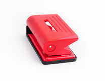 Small office puncher. Small Red office puncher on the white background Royalty Free Stock Photos