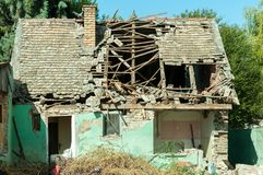 Small old and abandoned house demolished of the earthquake destruction. Stock Images