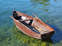 Small old boat. Small old peddle boat on the Ohrid lake Macedonia Royalty Free Stock Photo