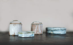 Small old boxes painted white on the wooden table stock photo