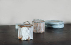 Small old boxes painted white on the wooden table royalty free stock photos