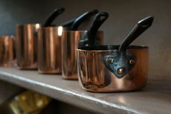Small old copper kitchen pans Stock Images