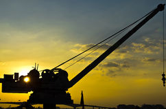 Small and old crane in sunset Stock Images