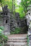 Old dark castle in the green forest. Small old dark castle in the green forest stock photos