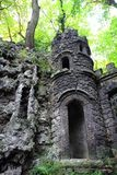 Old dark castle in the green forest. Small old dark castle in the green forest Royalty Free Stock Photo