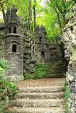 Old dark castle in the green forest. Small old dark castle in the green forest stock photo