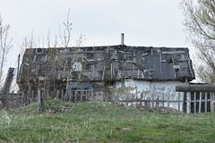 Small old dilapidated house with a leaky roof royalty free stock images