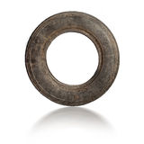 Small old dirty tire isolated Stock Photo