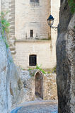 Small Old Doorway in Avignon France. A small arched doorway through a stone wall in medieval Avignon France Stock Image