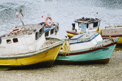 Small old fishing boats on the beach at Puerto Montt Stock Images