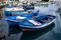 Small old fishing boats at sea port in Italy royalty free stock image