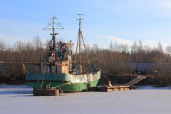 Small old fishing trawler at wintering Stock Images