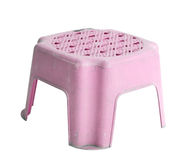 Small old pink plastic stool isolated on white. Background Royalty Free Stock Photo