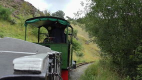 Small old quarry steam train. Riding an old small steam engine train in summer stock footage