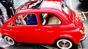 Small old red car. A tiny red car, with open roof from unknown manufacturer royalty free stock images