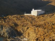 A small white church. A small old stone white church on the hill on the Kythnos island. Greece. Mediterranean sea Stock Photo