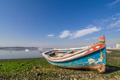 Small, old traditional boat in Seixal bay Royalty Free Stock Photography